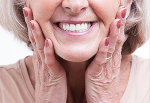 Older lady smiling with her new dentures